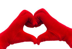 Hands in red gloves show heart shaped sign on white isolated background with clipping path. Royalty Free Stock Image