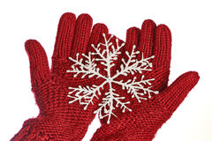 Hands in red gloves with snowflakes Royalty Free Stock Images