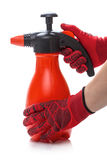Hands in red gloves and a sprayer Royalty Free Stock Photo