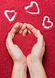 Hands and red hearts Royalty Free Stock Photos