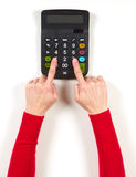 Hands in red jacket and black calculator Stock Images