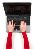 Hands in red jacket and black laptop Stock Photos