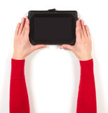 Hands in red jacket and tablet Stock Photo