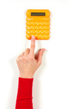 Hands in red jacket and yellow calculator Royalty Free Stock Photography