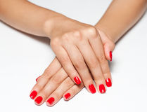 Hands with red manicure Stock Photos