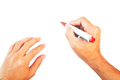 Hands with red marker isolated Royalty Free Stock Images