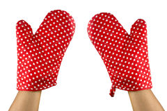 Hands and red oven glove Royalty Free Stock Image