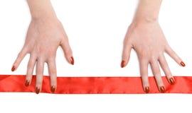 hands red ribbon woman Στοκ Φωτογραφία