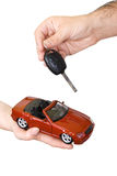 Hands with red sports car and key Stock Photos