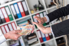 Hands rejecting an offer of money Stock Photos