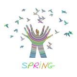 Hands releasing a flock of birds. Spring. Stock Photos