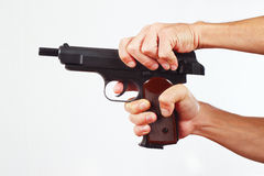 Hands reload gun on white background Stock Photo