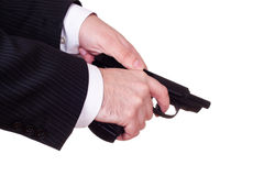 Hands reload pistol Royalty Free Stock Images