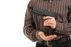 Hands reload pistol Royalty Free Stock Photo