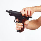 Hands reload pistol on white background Royalty Free Stock Photos