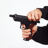Hands reload semi-automatic pistol Stock Image