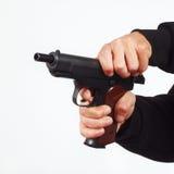 Hands reload semi-automatic pistol Stock Image