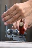 Hands reloading cartridge, closeup. Hands reloading cartridge by shotgun shell reloader, closeup Royalty Free Stock Image