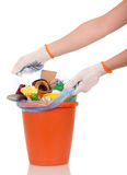 Hands are removed from  bucket bag with household waste. Women's hands are removed from the bucket bag with household waste isolated on white background Stock Photography
