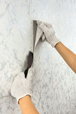 Hands removing old wallpaper with spatula Stock Photography