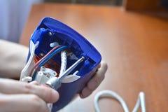 Hands repair iron. Concept: home appliance repair, repair services stock image