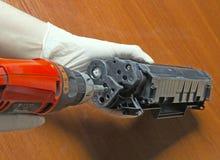 Hands repairing laser toner cartridge Royalty Free Stock Photo