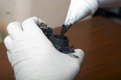 Hands repairing laser toner cartridge Stock Photos