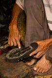 Hands repairing shoes, Kathmandu, Nepal Royalty Free Stock Photos