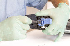 Hands repairing toner cartridge Stock Photos