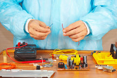 Hands repairman servicing electronic devices in service workshop Royalty Free Stock Photography