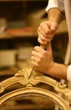 hands restaurator Arkivfoto