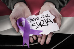Hands with ribbon and pray for Syria Royalty Free Stock Image