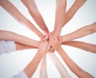 Hands ringer teamwork fotografering för bildbyråer