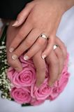 Hands and rings. Hands wedding rings and bouquet Royalty Free Stock Photos