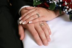 Hands and rings. Husband and wife with hands and wedding rings together Stock Photos