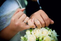 Hands with rings. And wedding bouquet Stock Photos