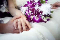 Hands and rings on bouquet Royalty Free Stock Image