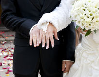 Hands with rings  and bouquet Royalty Free Stock Photos
