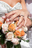 Hands with rings and flower bouquet Royalty Free Stock Image