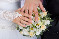 Hands and rings on wedding bouquet royalty free stock photos