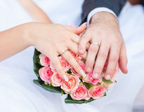 Hands and rings it is wedding bouquet Royalty Free Stock Photo