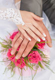 Hands and rings it is wedding bouquet Stock Photography