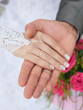 Hands and rings it is wedding bouquet Stock Photo