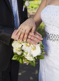 Hands and rings on wedding bouquet Royalty Free Stock Photo