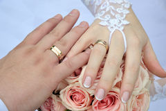 Hands and rings on wedding bouquet. Hands and rings just merried on wedding bouquet Stock Image
