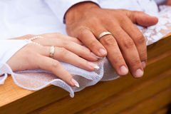 Hands and rings on a wedding veil. Hands of bride and groom and rings on a wedding veil Royalty Free Stock Images