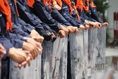 Hands of riot police. Holding shields, standing in line to receive the training Royalty Free Stock Photo