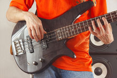 Hands of rock guitarist playing bass guitar Royalty Free Stock Images