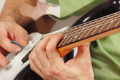Hands of a rock guitarist put guitar chords Stock Images