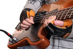 Hands of a rock musician Stock Photography